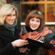 Young businesswomen with a folder — Stock Photo