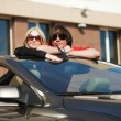 Young couple in a convertible car — Stock Photo #11391899