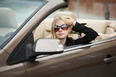 Young woman in a convertible car — Stock Photo