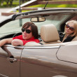 Young couple in a convertible car — Stock Photo #11688750