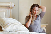 Beautiful woman in a bedroom — Stock Photo