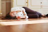 Beautiful woman lying on the parquet floor — Fotografia Stock