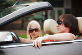 Young couple in a convertible car — Stock Photo