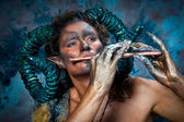 Faun playing the flute — Stock Photo