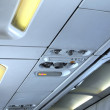Fragment of   interior view of modern Airplane. - Stock Photo