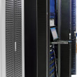 Telecommunication equipment  in a datacenter.Cabinets - Stock Photo