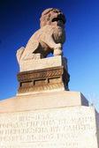 Granite lion on the embankment in St. Petersburg — Stock Photo
