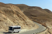 Tour Bus on Deserted road, Israel — Stock Photo