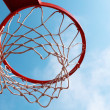 Basketball hoop on blue sky - Stock Photo