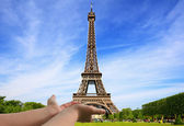 The Eiffel Tower at your fingertips — Stock Photo