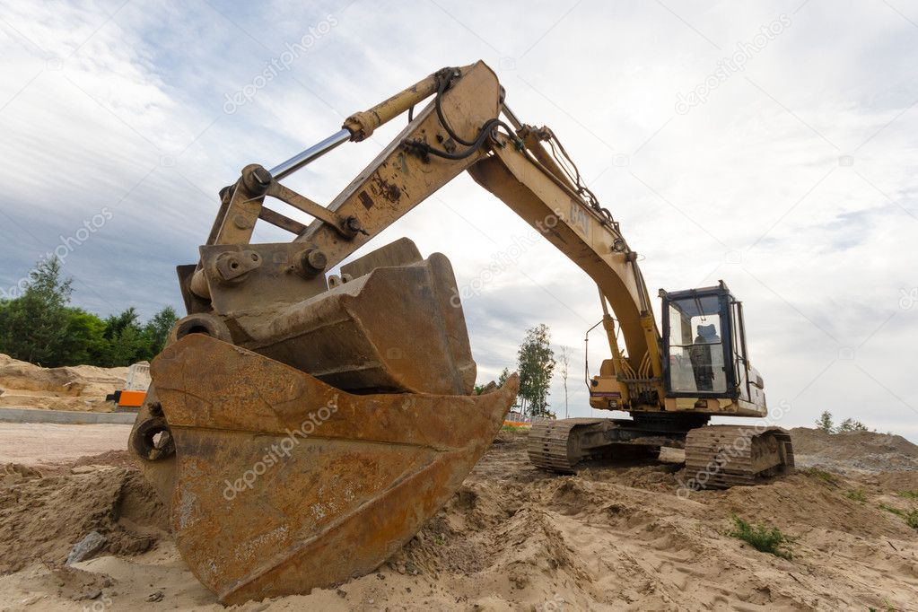 Digger, heavy duty construction equipment parked at work site — Stock Photo #11436657