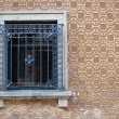 House window with grating — Stock Photo