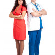 Professional young doctor and sexy nurse — Stock Photo