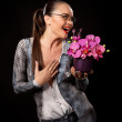 Sexy executive woman with purple flowers — Stock Photo