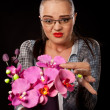Sexy executive woman with purple flowers — Foto Stock