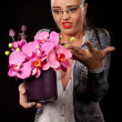 Royalty-Free Stock Photo: Sexy executive woman with purple flowers