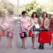 Group of friends with shopping bags — Stock Photo #11289239