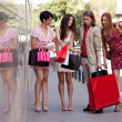 Group of friends with shopping bags — Photo