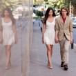 Young couple walking on the street — Stockfoto
