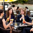 Stock Photo: Group of friends enjoying cocktails