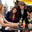 Group of friends enjoying cocktails — Stock Photo