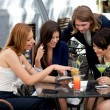 Group of friends enjoying cocktails — Stock Photo #11289576