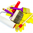 Brushes of various sizes with yellow gloves and roller — Stock Photo