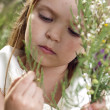 Portrait of beautiful little girl with the field flowers — Stock Photo #11037467