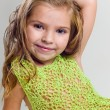 Beautiful little girl with stocking clothes and jeans in a studi — Stock Photo