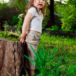 Amusing little girl sits on hemp — Stock Photo #11039907