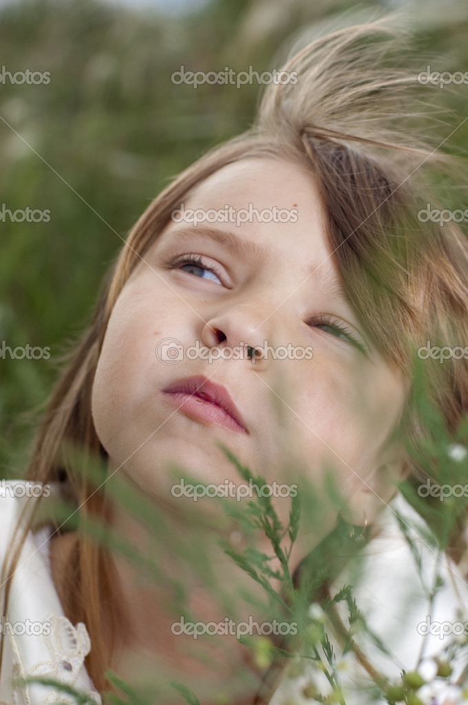 Portrait of beautiful little girl with the field flowers — Stock Photo #11037498