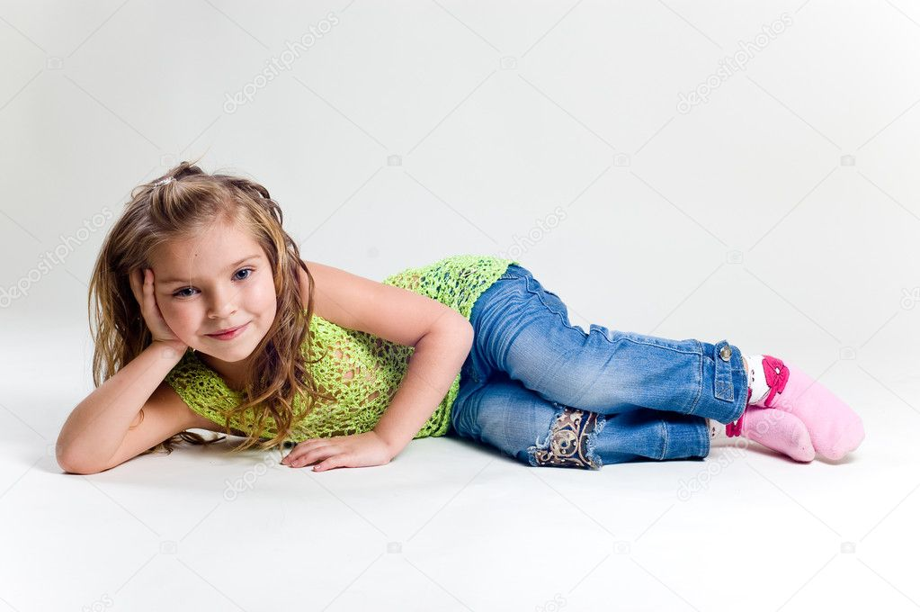 Beautiful little girl with stocking clothes and jeans in a studio — Stock Photo #11039001