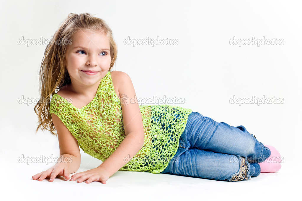 Beautiful little girl with stocking clothes and jeans in a studio — Stock Photo #11039032