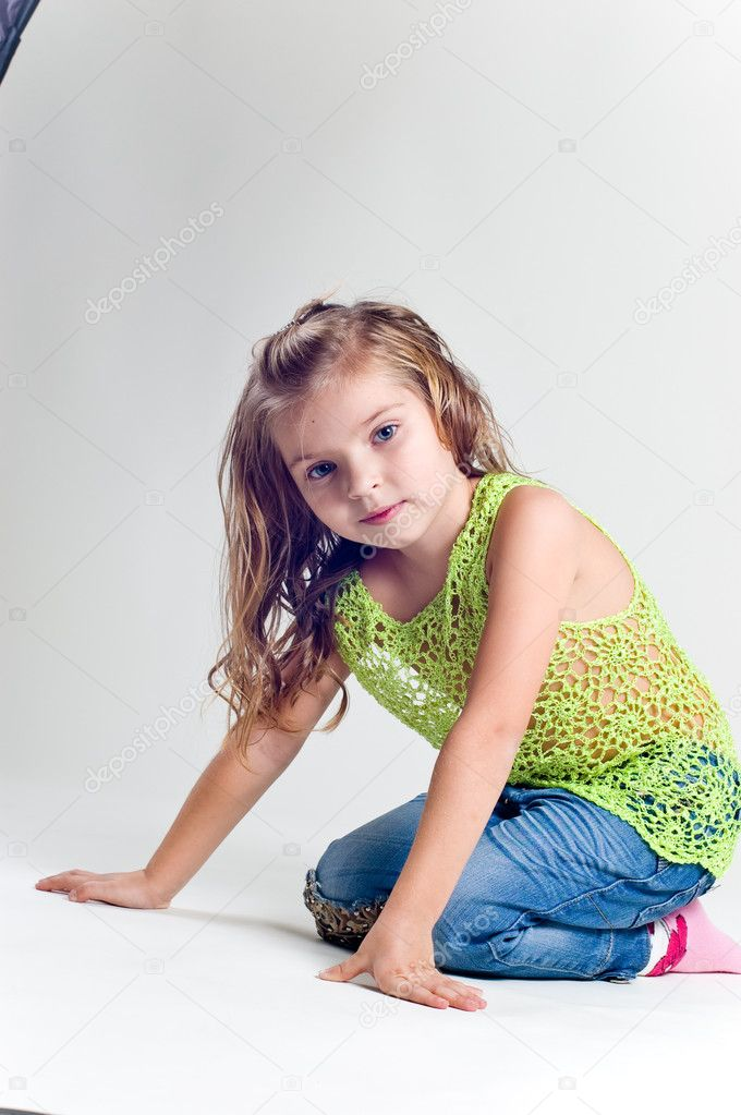 Beautiful little girl with stocking clothes and jeans in a studio — Stock Photo #11039061