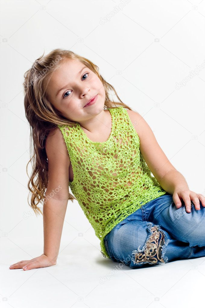 Beautiful little girl with stocking clothes and jeans in a studio  Photo #11039125