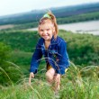Beautiful little girl in jean clothes on a walk outdoors — Foto de Stock