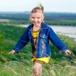 Beautiful little girl in jean clothes on a walk outdoors — Stock fotografie