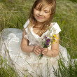 Beautiful girl in the clothes of bride on the field with the fie — Stock Photo #11040562