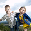Foto Stock: Amusing children on a background a landscape