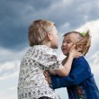 Little boy and girl is kissed on a background a landscape — Stock Photo