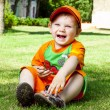 Little boy is in summer on a lawn — Stock Photo