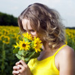 Sun young girl in the field with sunflowers — Stock Photo