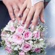 Wedding bouquet from tender roses, hands and rings — Stock Photo