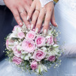Wedding bouquet from tender roses, hands and rings — Stock Photo #11108332