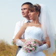 Stock Photo: Happy bride and groom outdoors