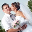 Happy bride and groom in wedding day outdoors — Stock Photo