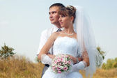Happy bride and groom outdoors — Stock Photo
