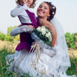 Wonderful young bride and beautiful little girl outdoors — Stock Photo