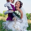 Wonderful young bride and beautiful little girl outdoors — Stock Photo #11124191