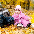 Little boy and girl play in a park in autumn — Stock Photo